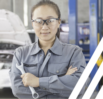 woman wearing safety glasses and holding wrench