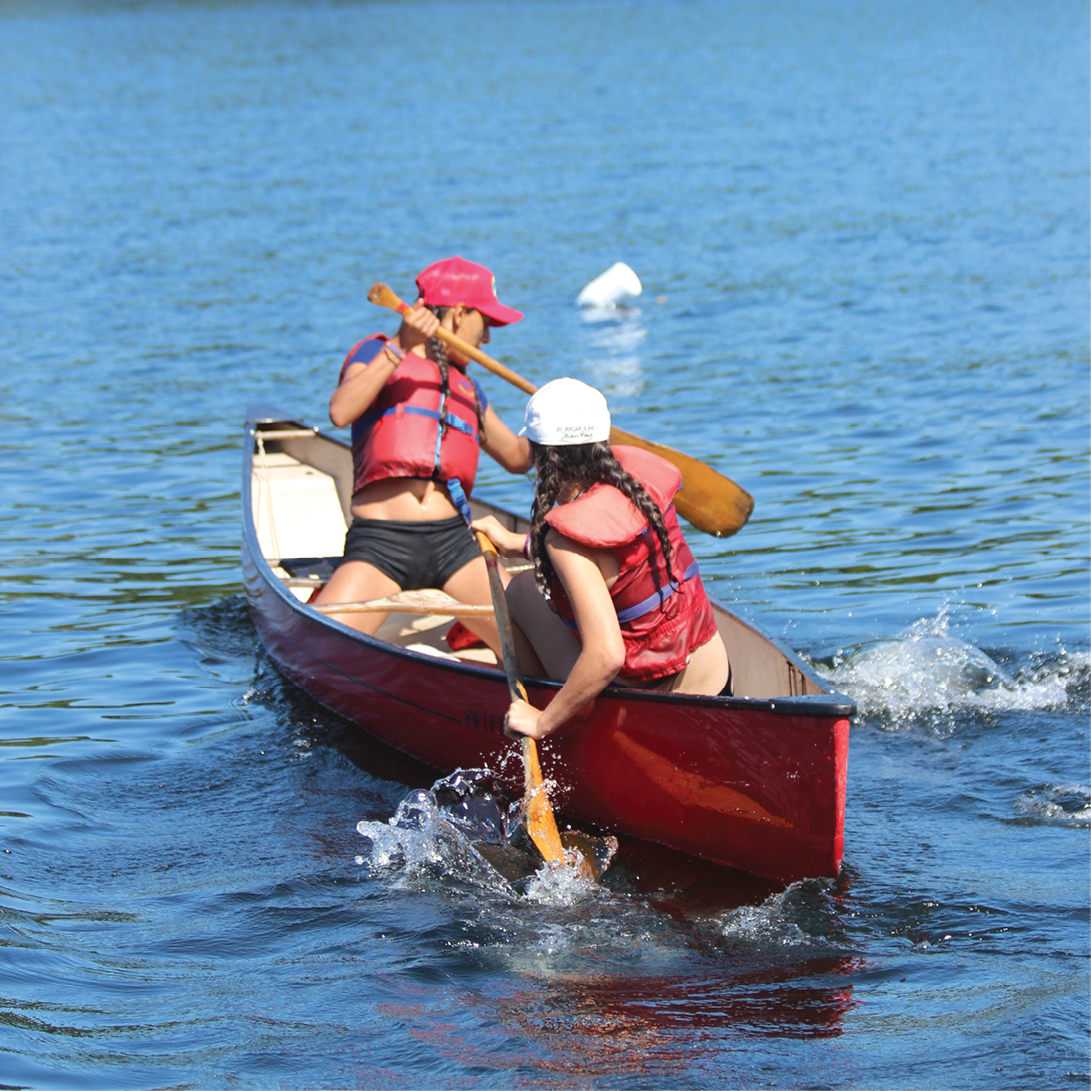 2 girls in red canoe in lake