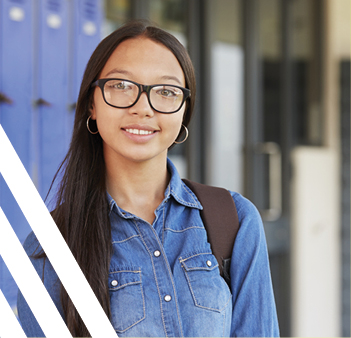 asian girl with glasses against backdrop of blue lockers