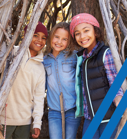three girls in wooded structure